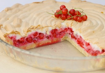 Piece of red currant pie with beaten egg whites