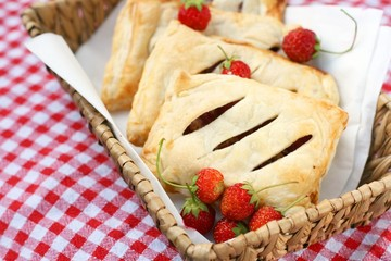 Danish pastry pockets or mini pies with strawberry