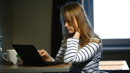 Woman working with laptop at home
