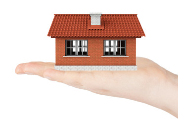Real Estate Concept. House model in the hand