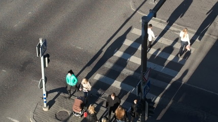 People crossing the street on green light