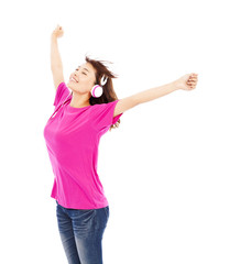 Young beautiful woman enjoying the music and raising arms