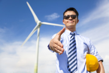 business man handshake cooperate to do wind power fuel