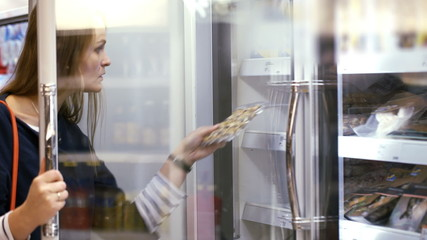 Woman choosing products in the frozen section
