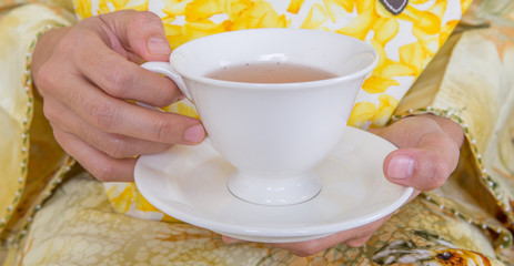 Female hands holding a cup of tea