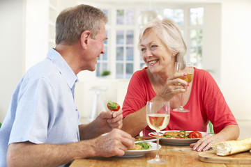 Retired couple enjoying meal at home
