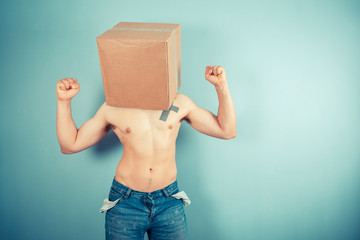 Young man with cardboard box on his head