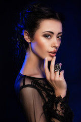 Fashion studio shot of beautiful woman with makeup and hairstyle