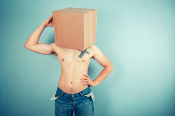 Confused young man with box on his head