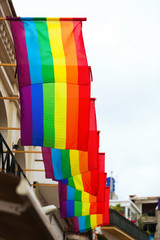 rainbow flags on houses
