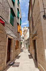 Narrow medieval street in Trogir, Croatia
