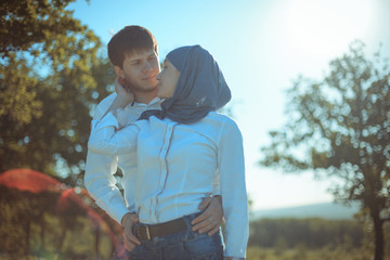 Romantic young couple relaxing outdoors in park