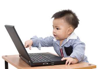 Boy using a laptop computer