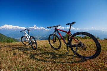Two bikes on the background of the Himalayan mountains