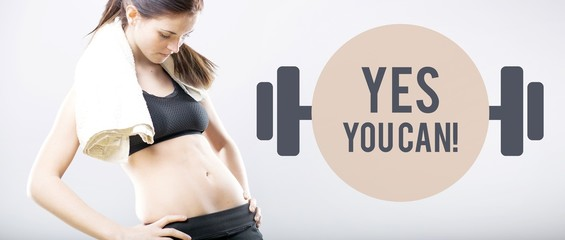 Yes you can, woman looking at flat belly