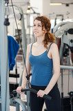 Young woman training in the gym.