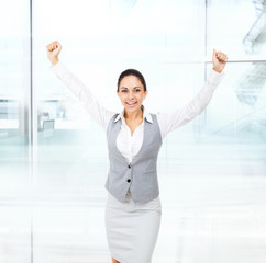 Business woman excited hold hands up raised arms