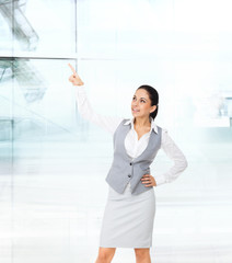 Businesswoman smile point finger copy space