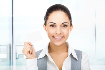 Businesswoman smile hold blank business card