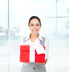 Business woman smile hold red gift box hands