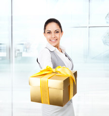 Business woman happy smile hold golden gift box