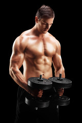 Handsome man exercising with two weights