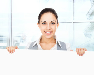 businesswoman holding a blank white card board