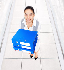 Businesswoman smile, hold blue stack folder