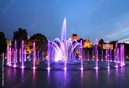 The illuminated fountain at night - 66779613