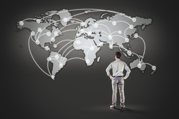 business man standing in front of world map background