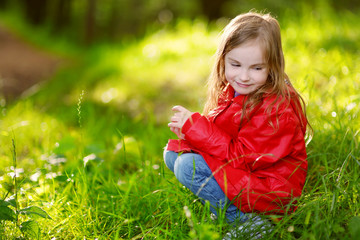 Adorable little girl having fun on autumn day