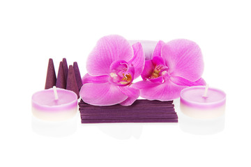 Orchid flowers, aromatic set and the candles