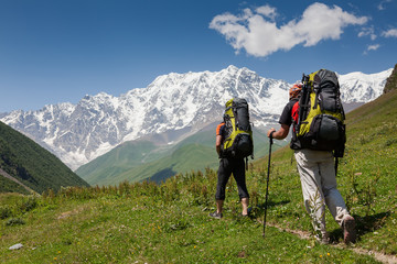 Hikers in Caucasus mountains of Zemo (upper) Svaneti, Georgia