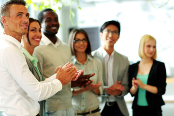 Group of a happy business team applauding
