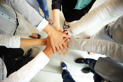 canvas print picture Business people joining hands
