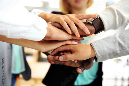 Leinwanddruck Bild Business people joining hands