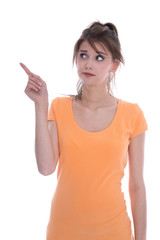 Portrait of an anxious isolated young girl in orange pointing wi
