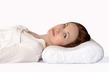 Young woman sleeping on an orthopedic pillow