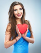 Young happy woman hold Love symbol red heart. Isolated on studi