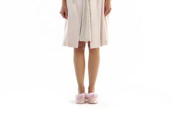 Woman dressed in pyjama isolated on white