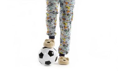 Boy dressed in pyjama and football ball