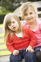 Girl with younger Downs Syndrome sister