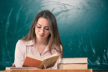 young teacher reading book