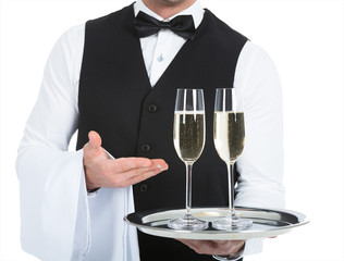 Waiter Carrying Champagne Flutes On Tray