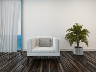 Armchair and potted palm with a view of the sea