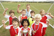 Winning junior football team portrait with coach