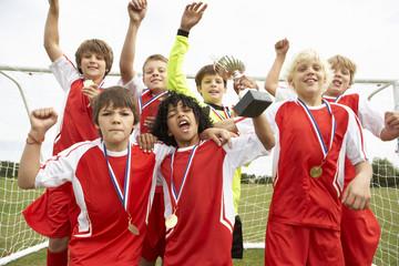 Winning junior soccer team portrait