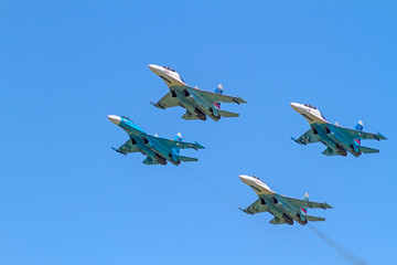 Four Su-27 in the blue sky