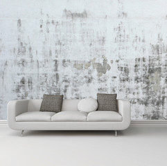 Greyscale image of a sofa against an abstract wall