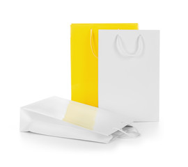 white and yellow gift bags on an isolated white background